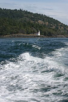 Boat Wake And Lighthouse Royalty Free Stock Photography