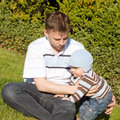 Free Father And Son On The Grass Stock Photo - 14898780