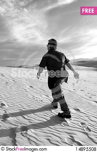 Free Man Hiking Up Dune Royalty Free Stock Photos - 14895508