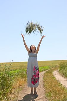 Free The Girl Throws Upwards A Bunch Of Flowers Stock Photos - 14892643