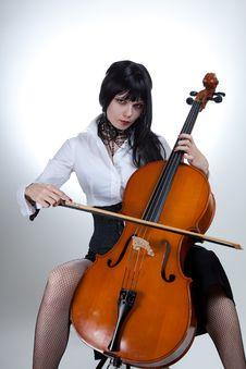 Young Woman Playing Cello Stock Photos