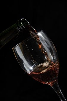 Pouring Wine In Glass From A Bottle Royalty Free Stock Photography