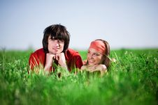Boy And Smiling Girl On Grass Stock Photos