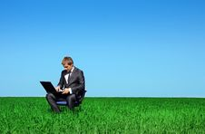Successful Businessman In The Green Meadow Royalty Free Stock Images