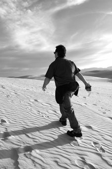 Free Man Hiking Up Dune Royalty Free Stock Photos - 14895508