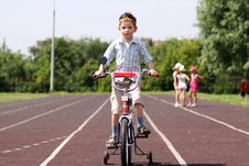 Boy Goes For A Drive On A Bicycle Royalty Free Stock Photos