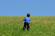 Free Boy Climbing A Hill Stock Photography - 1498692