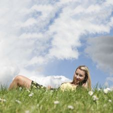 Free Girl Laying On Grass Hill Royalty Free Stock Photos - 14901568