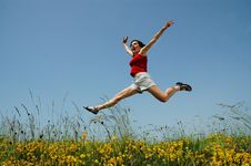 Beautiful Young Girl Jumping Royalty Free Stock Photo