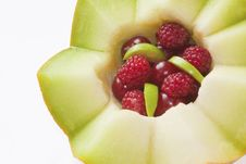 Zigzag Melon With Cherry And Raspberry Stock Images