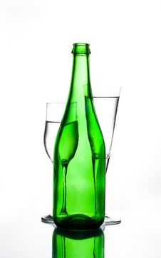 Green Bottle And Two Glasses Royalty Free Stock Image