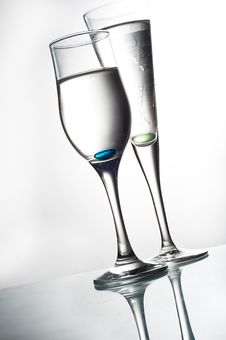 Free Two Glasses On Glass Table Royalty Free Stock Photo - 14909605