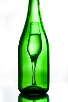 Green Bottle And Glasses Stock Image
