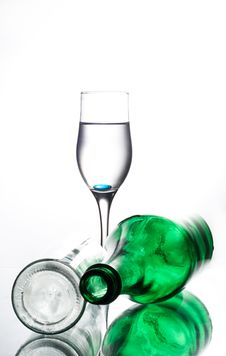 Green Bottle And Two Glasses Stock Images