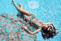 Free Girl Relaxing In A Pool Stock Photography - 14912762