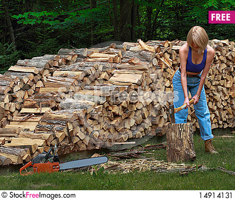 Girl Splitting Firewood - Free Stock Photos & Images ...