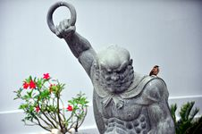 Free Fierce Statue And A Little Bird Stock Image - 14910451