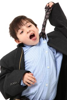Adorable Boy In Over Sized Suit Stock Photo