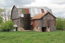 Old Barn With Roof Of Many Colors Stock Photos