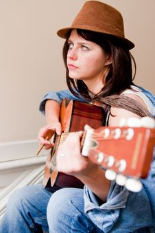 Young Woman Musician Playing Guitar Royalty Free Stock Photography