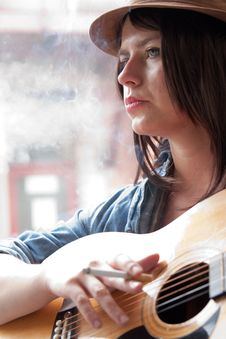Young Woman Musician Smoking Stock Images