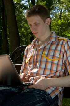 Free Young Man Using Laptop In Summer Park Royalty Free Stock Image - 14918256