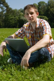 Free Young Man Using Laptop In Summer Park Stock Images - 14918264