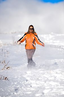 Woman Running On The Snow Royalty Free Stock Image