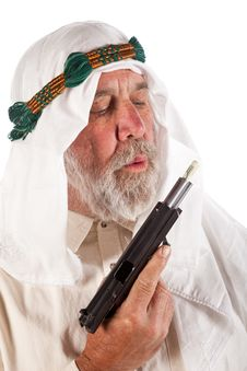 Arab Man Blowing On Money Stuffed In A Gun Royalty Free Stock Photo