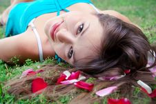 Lying Girl And Petals Of Rose Royalty Free Stock Image