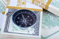 Close Up US Currency And Compass Concept Stock Image