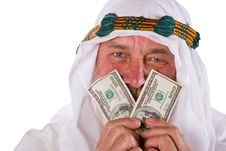 Arab Male Holding Money To His Face Stock Photo
