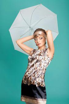 Beautiful Fashion Girl On The Turquoise Background Stock Photo