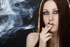 Young Woman Smoking Royalty Free Stock Image