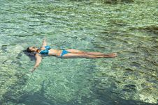 Woman Floating In Water Stock Images