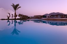 Sunset Reflection In Swimming Pool Royalty Free Stock Photos