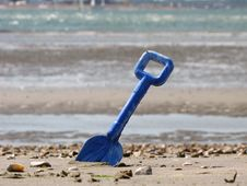 Free Blue Shovel In The Sea Sand Royalty Free Stock Image - 14927356