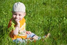 Free Beautiful Little Boy Looks In Green  Meadow Royalty Free Stock Image - 14929626
