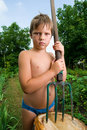 Free Serious Boy With A Pitchfork Royalty Free Stock Photography - 14937387