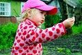 Free A Little Girl Handing A Berry Stock Photo - 14938890