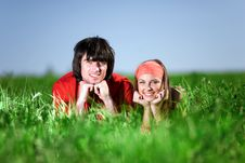 Smiling Girl And Boy On Grass Stock Images