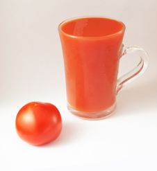 Red Tomato And A Glass Of Tomato Juice Stock Photo