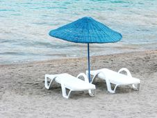 Sun-tent And Two Sun-beds On The Beach Stock Images