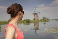 Woman Looking At Windmills Stock Photo