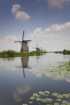 Traditional Windmills On River