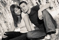 Portrait Of Cheerful Couple Sitting Under The Tree Stock Photography