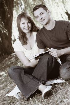Free Young Happy Couple Reading A Book Royalty Free Stock Image - 14938526