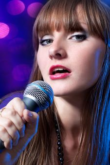 Free Portrait Young Woman Singing Into Microphone Stock Photo - 14939460