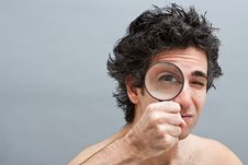 Free Curious Man With Magnifier Royalty Free Stock Photography - 14942027