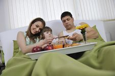 Free Happy Young Family Eat Breakfast In Bed Royalty Free Stock Photo - 14944345